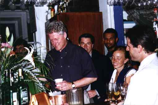 President Clinton enjoying a cup of coffee