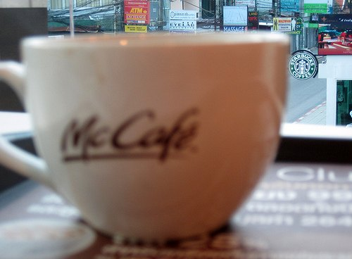 McCafe with a Starbucks in the background