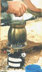 Stir campfire coffee