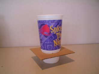 Cup inside the cut out cardboard