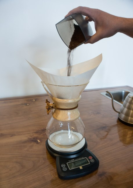 add ground coffee inside chemex coffee fitler