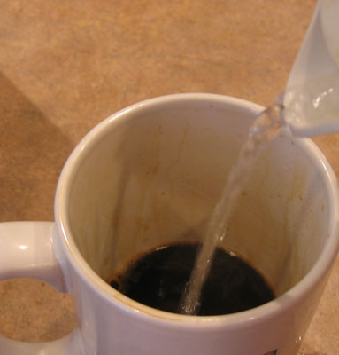 Add hot water to AeroPress brewed coffee.