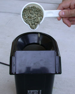 pour coffee into roaster