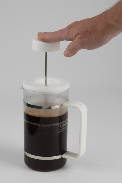 french press coffee plunging